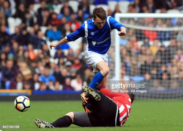 Sam Woodyatt and Che Chesterman battle for the ball during the Bradley Lowery charity match at Goodison Park Liverpool