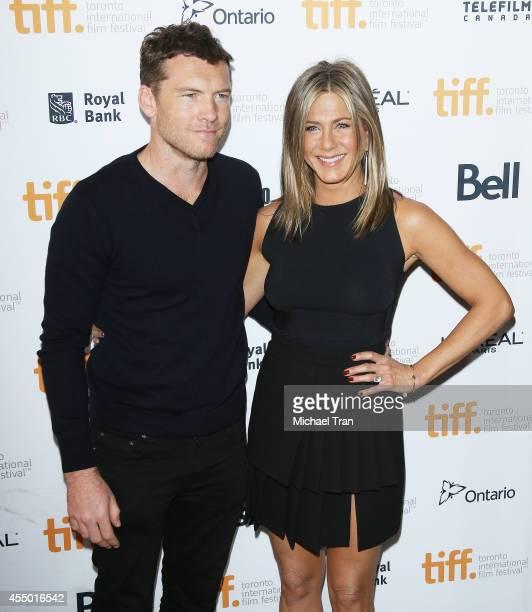 Sam Worthington and Jennifer Aniston arrive at the premiere of Cake held during the 2014 Toronto International Film Festival Day 5 on September 8...