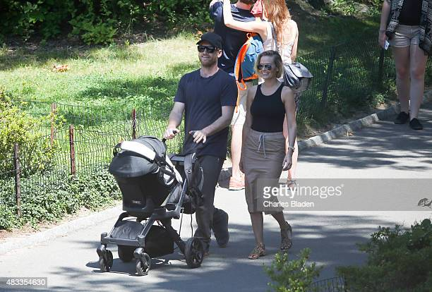 Sam Worthington and Lara Bingle are seen taking their baby boy Rocket for a walk in Central Park on August 7 2015 in New York City