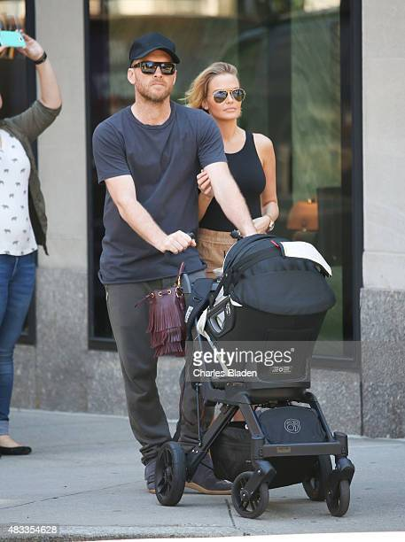 Sam Worthington and Lara Bingle seen taking their baby boy Rocket for a walk on August 7 2015 in New York City