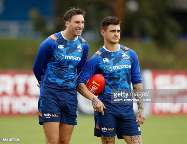 Sam Wright and Marley Williams of the Kangaroos look on during the North Melbourne Kangaroos training session at Arden St on December 4 2017 in...