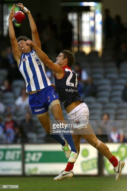 Sam Wright of the Kangaroos marks infront of Jared Rivers of the Demons during the round six AFL match between the North Melbourne Kangaroos and the...