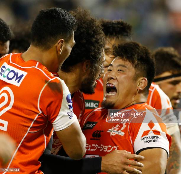 Sam Wykes of Sunwolves and teammates celebrate after scoring a try during the Super Rugby match between Jaguares and Sunwolves at Estadio Jose...
