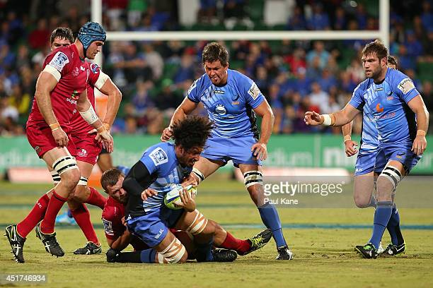Sam Wykes of the Force gets tackled by Curtis Browning of the Reds during the round 18 Super Rugby match between the Western Force and the Queensland...