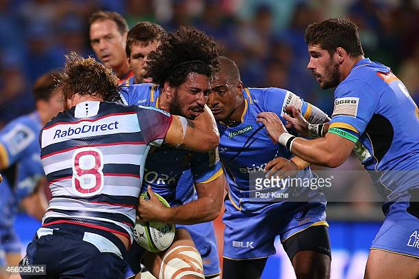 Sam Wykes of the Force gets tackled by Scott Higginbotham of the Rebals during the round five Super Rugby match between the Force and the Rebels at...