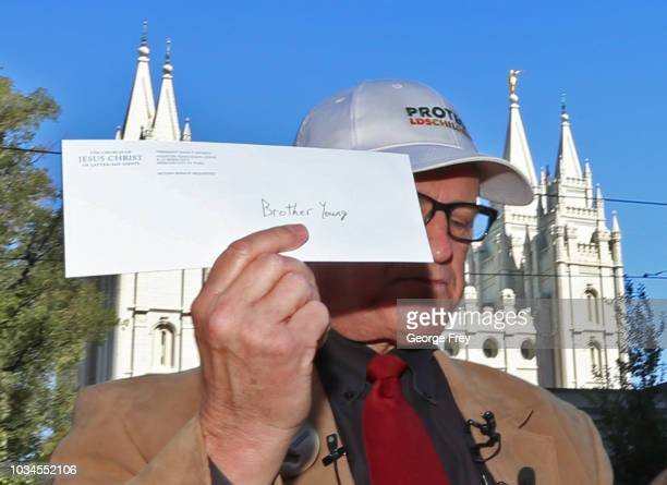 Sam Young former Mormon bishop and founder of Protect the Children holds up a letter that will tell him if he has been excommunicated from the Church...