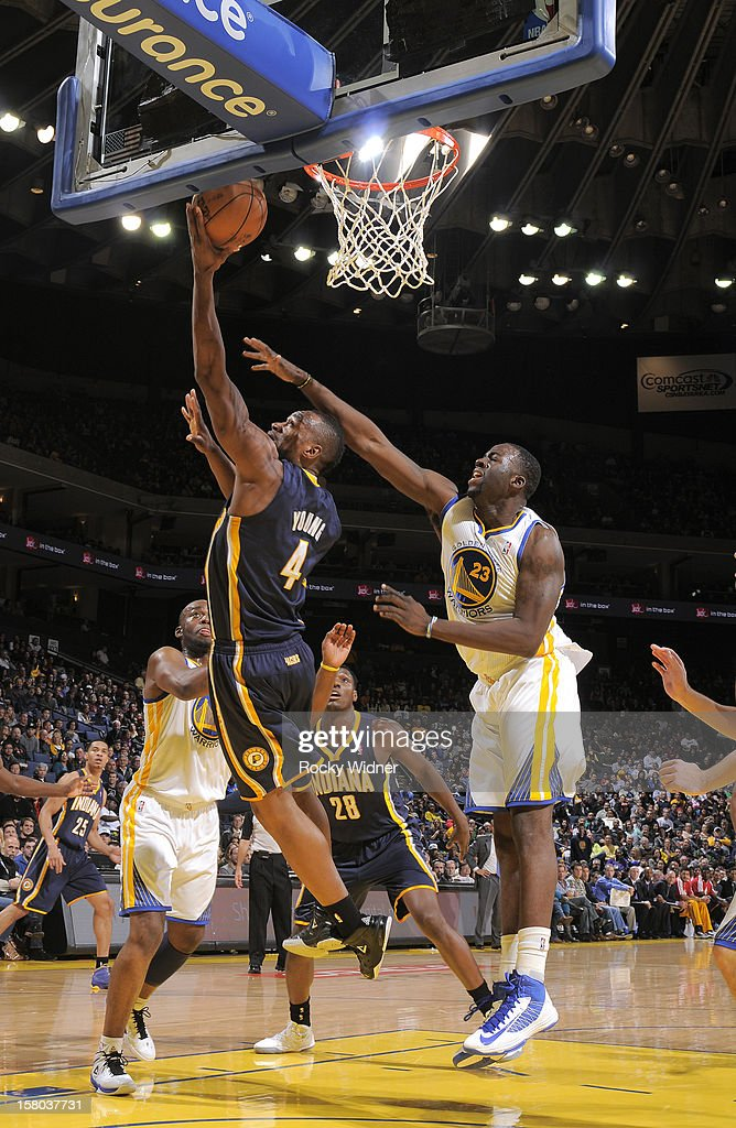 Sam Young #4 of the Indiana Pacers goes up for the shot against Draymond Green #23 of the Golden State Warriors on December 1, 2012 at Oracle Arena in Oakland, California.