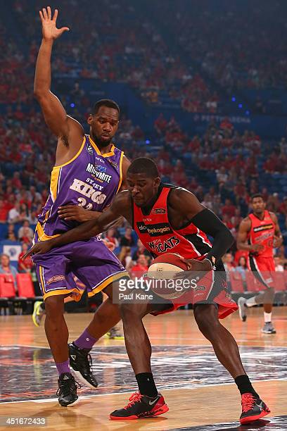 Sam Young of the Kings holds out James Ennis of the Wildcats during the round seven NBL match between the Perth Wildcats and the Sydney Kings at...