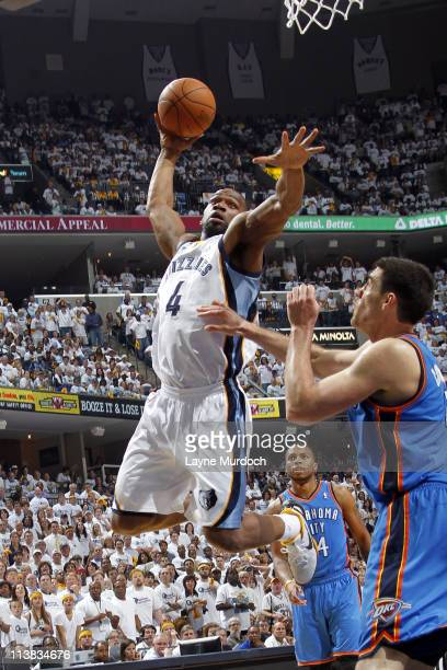 Sam Young of the Memphis Grizzlies dunks over Nick Collison of the Oklahoma City Thunder in Game Three of the Western Conference Semifinals during...