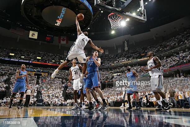 Sam Young of the Memphis Grizzlies dunks over Nick Collison of the Oklahoma City Thunder in Game Three of the Western Conference Semifinals in the...