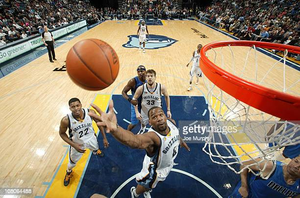 Sam Young of the Memphis Grizzlies rebounds against the Dallas Mavericks on January 15 2011 at FedExForum in Memphis Tennessee NOTE TO USER User...