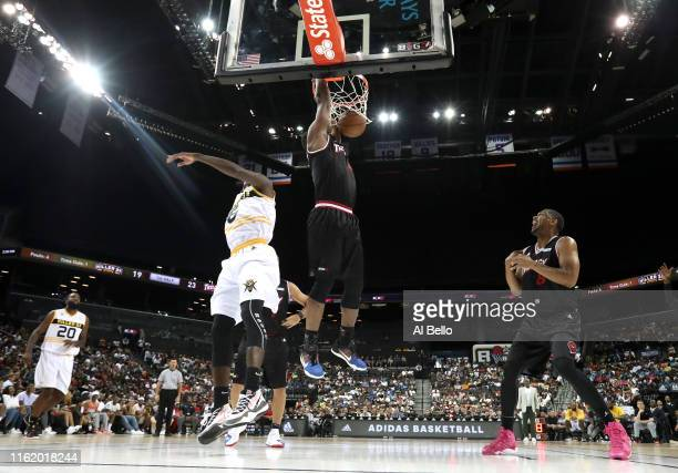 Sam Young of Trilogy dunks against Frank Session of Killer 3s during week four of the BIG3 three-on-three basketball league at Barclays Center on...