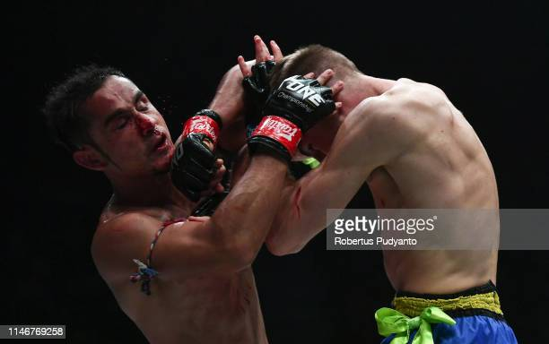 SamA Gaiyanghadao of Thailand fights against Jonathan Haggerty of England during the ONE Super Series Flyweight Muay Thai World Championship at...