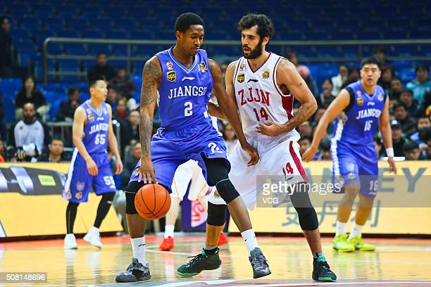 Samad Nikkhah Bahrami of Zhejiang Golden Bulls defends against MarShon Brooks of Jiangsu Dragons during the 37th round of the Chinese Basketball...