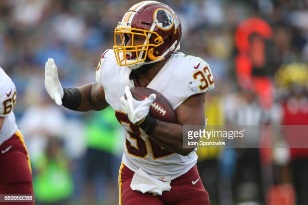 Samaje Perine of the Washington Redskins runs the ball during a NFL game between the Washington Redskins and the Los Angeles Chargers on December 10...