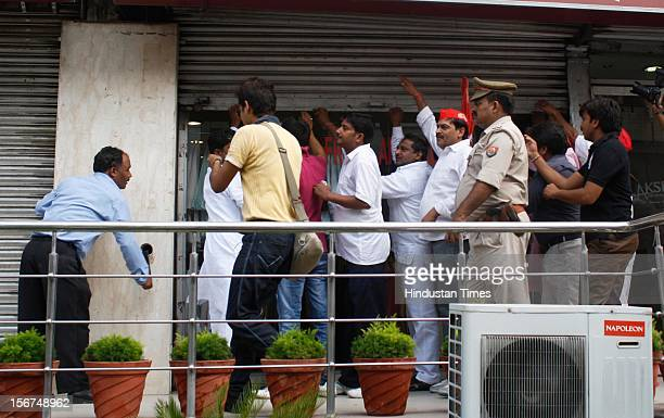 Samajwadi Party activists & supporters forcibly closing the shops during a nation wide strike or Bharat Bandh at Sector 18, on September 20, 2012 in...