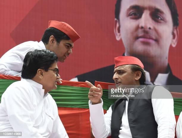 Samajwadi Party chief Akhilesh Yadav waves to supporters during a public rally at Jantar Mantar on September 23 2018 in New Delhi India