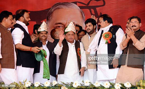 Samajwadi Party Chief Mulayam Singh Yadav and his brother Shivpal Singh Yadav during a campaign rally at Ghazipur ITI Ground on November 23 2016 near...