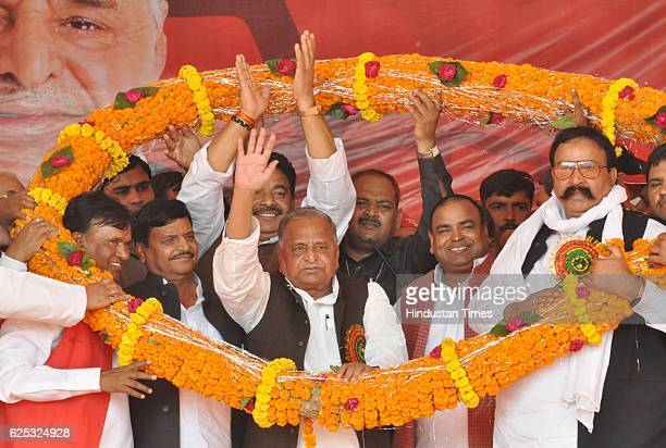 Samajwadi Party Chief Mulayam Singh Yadav and his brother Shivpal Singh Yadav with other party leaders wearing a garland during a campaign rally at...