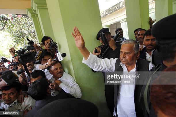 Samajwadi Party chief Mulayam Singh Yadav and his son and party state unit president Akhilesh Yadav leave the party parliamentary board meeting at...