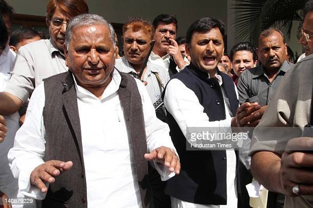 Samajwadi Party chief Mulayam Singh Yadav and his son and party state unit president Akhilesh Yadav arrive for the party parliamentary board meeting...