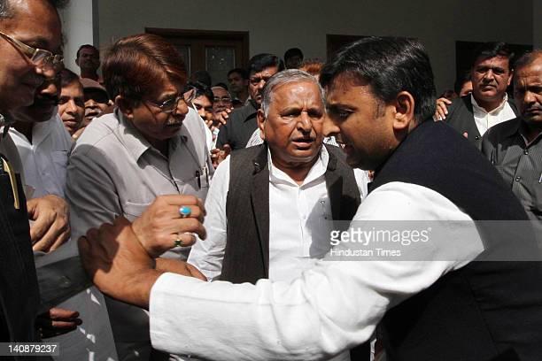 Samajwadi Party chief Mulayam Singh Yadav and his son and party state unit president Akhilesh Yadav attend the party parliamentary board meeting at...