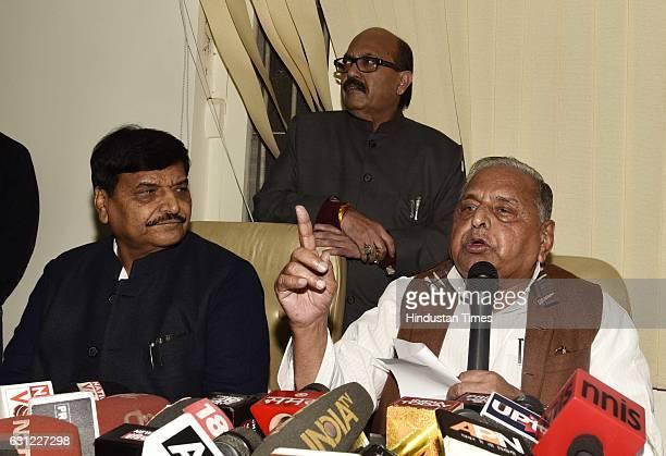 Samajwadi Party Chief Mulayam Singh Yadav with Amar Singh and Shivpal Yadav briefs media at his Delhi residence on January 8 2017 in New Delhi India...