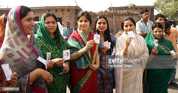Samajwadi party leader Akhilesh Yadav's wife Dimpal Yadav and her MotherinLaw Sadhana Yadav with other family members show their Voter ICards after...