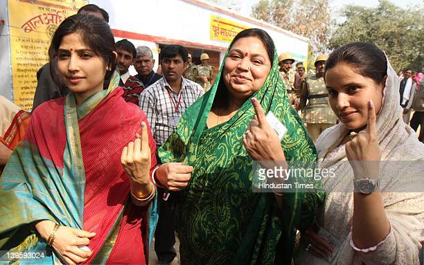 Samajwadi party leader Akhilesh Yadav's wife Dimpal Yadav with her MotherinLaw Sadhana Yadav show their ink marked fingers after casting their vote...