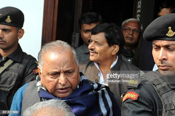Samajwadi Party leader Mulayam Singh Yadav along with his brother and party leader Shivpal Yadav after addressing his supporters at his residence on...