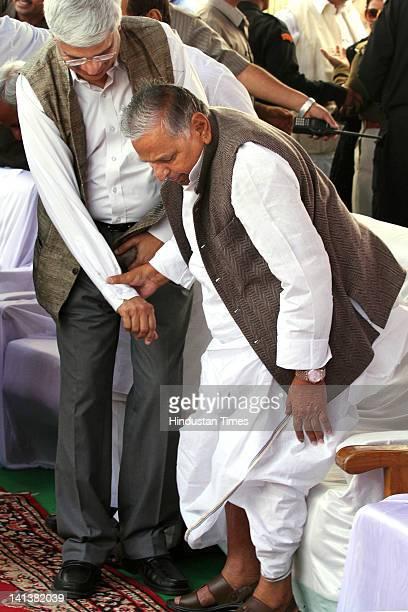 Samajwadi party leader Mulayam Singh Yadav and Communist Party of India leader Prakash Karat attend the oath-taking ceremony of Akhilesh Yadav as the...