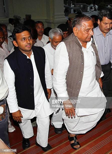 Samajwadi Party leader Mulayam Singh Yadav and his son Akhilesh Yadav arrive for a meeting with Governor of Uttar Pradesh Banwari Lal Joshi at the...