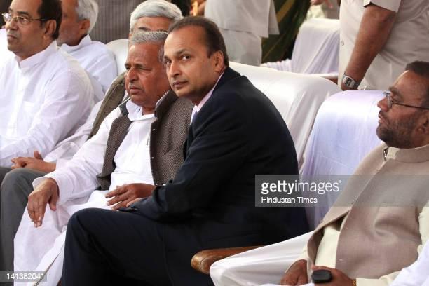 Samajwadi party leader Mulayam Singh Yadav, industrialist Anil Ambani, Bahujan Samaj Party leader Swami Prasad Maurya and other guests attend the...