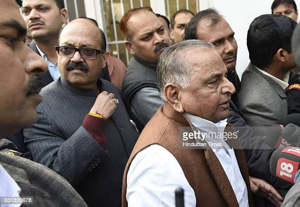 Samajwadi Party leaders Mulayam Singh Yadav Shivpal Singh and Amar Singh after meeting with Election Commission talking to his party workers at...