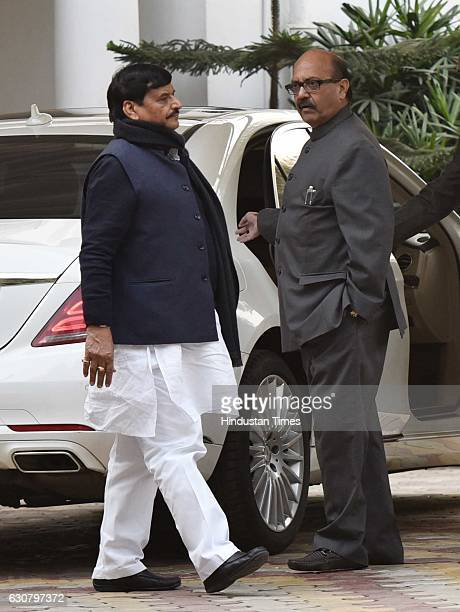 Samajwadi Party leaders Shivpal Yadav and Amar Singh at Mulayam Singh Yadav's residence before leaving to meet Election Commission to stake claim to...