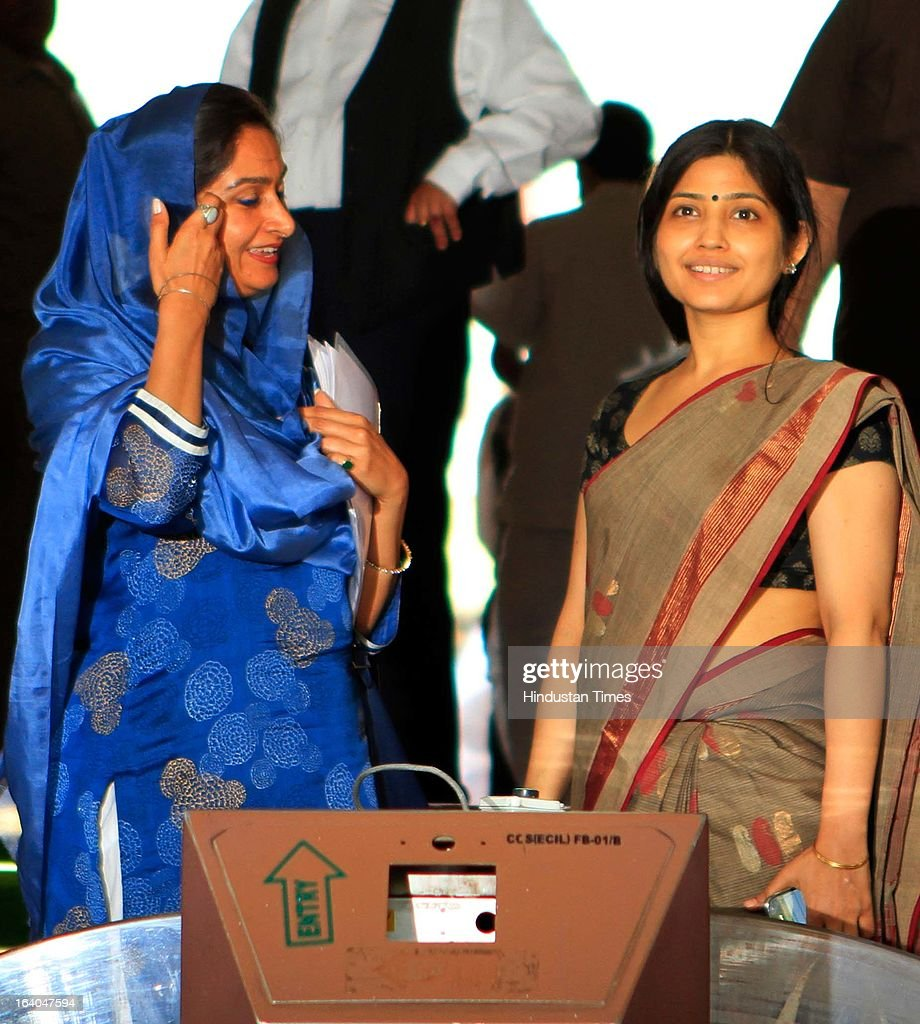 Samajwadi Party MP Dimple Yadav (R) and SAD MP Harsimrat Kaur at Parliament house during the on going budget session on March 19, 2013 in New Delhi, India. DMK today withdrew its support to the UPA and pulled out its five central ministers over the issue of alleged human rights violations of Tamils in Sri Lanka . The DMK has 18 Lok Sabha MPs and six Rajya Sabha MPs and was the second largest constituent of the Government. With the DMK pullout, the strength of the UPA in the Lok Sabha will be reduced to 224 but with outside support of SP (22) and BSP (21) it enjoyed the support of 281 MPs above the half way mark of 270.
