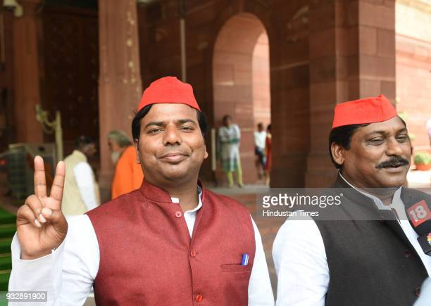 Samajwadi party newly elected MPs Nagendra Partap Sing Patel and Pravin Kumar Nishad show victory sign during the Parliament session at Parliament...