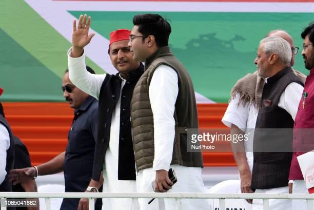 Samajwadi Party president Akhilesh Yadav Left waves to supporters and ABHISHEK BANERJEE MP and nefew of Mamata Banerjee CM of West Bengal during a...