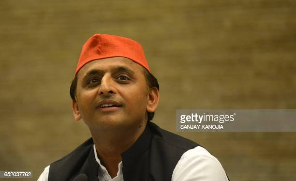 Samajwadi Party president and former Uttar Pradesh chief minister Akhilesh Yadav speaks during a press conference at his residence after defeat in...