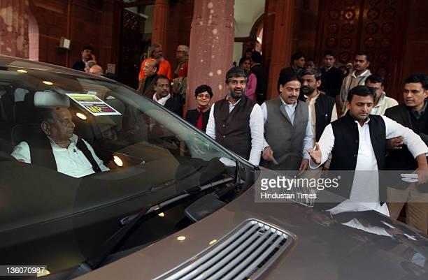 Samajwadi Party President Mulayam Singh Yadav and Akhilesh Yadav appear at Parliament House on December 22, 2011 in New Delhi, India. Two bills were...