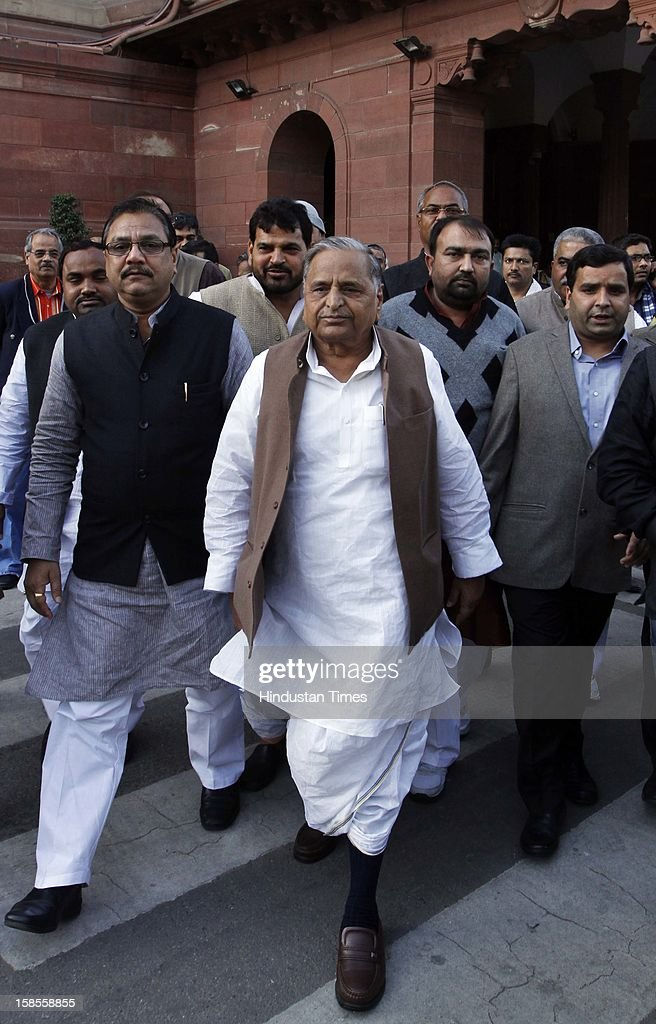Samajwadi Party president Mulayam Singh Yadav with MP, Yashvir Singh (2 R), who snatched the copy of SC/ST Quota Bill from Narayanasamy in Lok Sabha at Parliament House on December 19, 2012 in New Delhi, India.