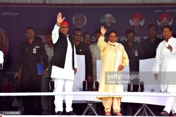 Samajwadi Partys Akhilesh Yadav, Bahujan Samaj Partys Mayawati and Rashtriya Lok Dal's Ajit singh greet the crowd at a rally at Seer Govardhanpur, on...