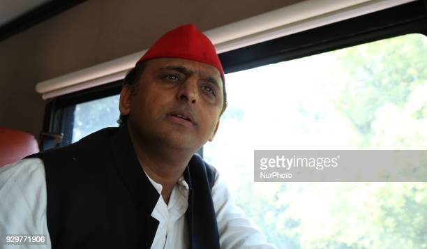 Samajwadi Party's national president and former Chief Minister of state of Uttar Pradesh Akhilesh Yadav speaks during his road show for the by poll...