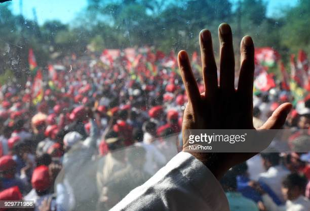 Samajwadi Party's national president and former Chief Minister of state of Uttar Pradesh Akhilesh Yadav waves towards party supporters during his...