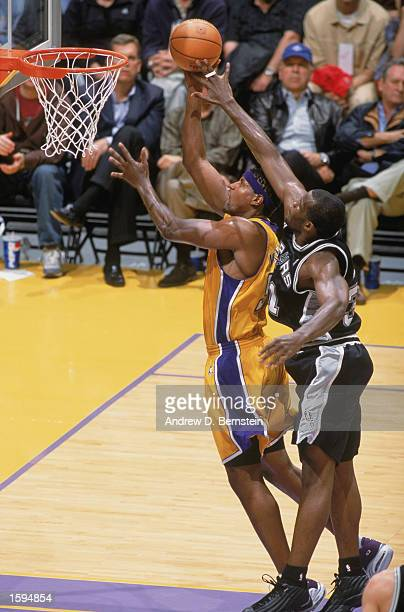 Samaki Walker of the Los Angeles Lakers shoots past Malik Rose of the San Antonio Spurs during the NBA game at Staples Center on October 29 2002 in...