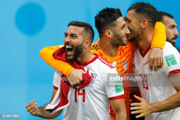 Saman Ghoddos Ali Beiranvand and Majid Hosseini of IR Iran national team celebrate a goal during the 2018 FIFA World Cup Russia Group B match between...