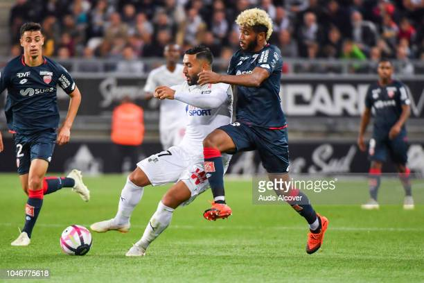 Saman Ghoddos of Amiens and Valentin Rosier of Dijon during the Ligue 1 match between Amiens and Dijon at Stade de la Licorne on October 6 2018 in...