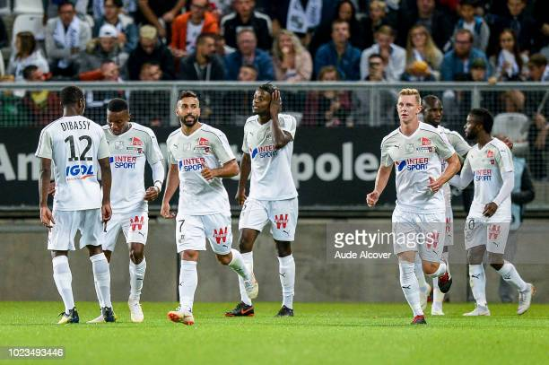 Saman Ghoddos of Amiens celebrates his goal with team mates during Ligue 1 match between Amiens and Reims on August 25 2018 in Amiens France
