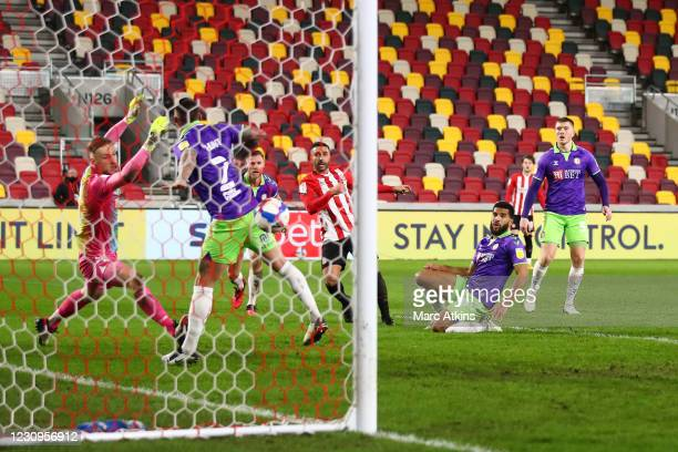 Saman Ghoddos of Brentford scores their 3rd goal during the Sky Bet Championship match between Brentford and Bristol City at Brentford Community...