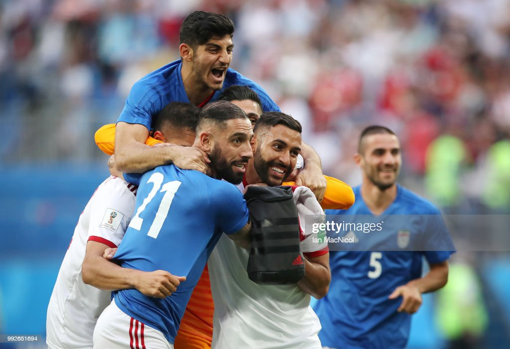 Saman Ghoddos of Iran celebrates with team mates at full time during the 2018 FIFA World Cup Russia group B match between Morocco and Iran at Saint Petersburg Stadium on June 15, 2018 in Saint Petersburg, Russia.